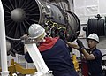 US Navy 041119-N-8539M-062 Sailors perform maintenance on an F-A-18 Hornet engine in the jet shop aboard USS Abraham Lincoln (CVN 72).jpg