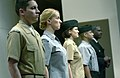 US Navy 041208-N-0962S-103 Four Navy Sailors stand at attention as they model the khaki and gray options of the year-round concept service uniform for Sailors E-6 and below.jpg