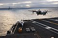 US Navy 050118-N-8148A-023 A C-2A Greyhound assigned to the Providers of Fleet Logistics Support Squadron Three Zero (VRC-30), prepares to land on the flight deck aboard USS Ronald Reagan (CVN 76).jpg