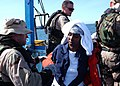 US Navy 050430-N-5526M-042 Sailors aid men and women after their boat, a fishing vessel, capsized 25 miles off the coast of Somalia.jpg