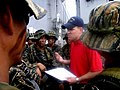 US Navy 050526-N-4104L-001 A U.S. Coast Guard law enforcement specialist debriefs members of a Philippine Navy SEAL team following a visit, board, search and seizure (VBSS) exercise aboard the dock landing ship USS Fort McHenry.jpg