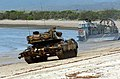 US Navy 050619-N-6811L-216 An Australian Army Leopard AS1 main battle tank moves up the beach at Sabina Point after being transported ashore by a U.S. Navy Landing Craft, Air Cushion (LCAC).jpg