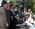 US Navy 050723-N-1026O-001 Commander Naval Air Forces Vice Adm. James Zortman, presents Mrs. Sybil Stockdale the American flag at a graveside service held at the U.S. Naval Academy Cemetery.jpg