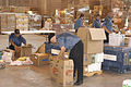 US Navy 050916-N-1512O-055 Canadian Sailors assigned to the patrol frigate HMCS Toronto (FFH 333) sort boxes of relief supplies at a Salvation Army warehouse managed by the Federal Emergency Management Agency (FEMA).jpg