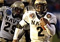 US Navy 051203-G-9409S-041 Navy Quarterback Lamar Owens (2) breaks into the sunshine just prior to crossing the goal line for a touchdown during the 106th Army vs. Navy Football game.jpg