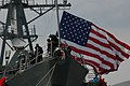 US Navy 060309-N-9562H-021 Sailors aboard the guided-missile destroyer USS Donald Cook (DDG 75) moor the ship at the pier on board Naval Station Norfolk.jpg