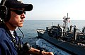 US Navy 060525-N-5174T-108 Operations Specialist 3rd Class Jeffrey Haskey stands a lookout watch during a vertical replenishment.jpg