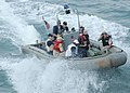 US Navy 061025-N-1598C-004 Sailors aboard a 7-meter rigid hull inflatable boat (RHIB) perform small boat operations alongside the amphibious assault ship USS Saipan (LHA 2).jpg