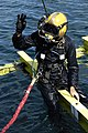 US Navy 070201-M-2067M-128 Navy Diver 1st Class Anthony Pierick, Mobile Diving and Salvage Unit One, Detachment Seven, Pearl Harbor, Hawaii, signals 'OK' to the dive supervisor off the coast of Aimeliik after securing bolts to.jpg