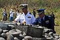 US Navy 070314-N-4124C-084 Japan Maritime Self Defense Force (JMSDF) Capt. Tomonori Kudo and Japan Air Self Defense Force (JASDF) Col. Shigemitsu Kurauchi conduct a Japanese ritual of spiritual purification.jpg