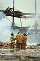 US Navy 070613-N-0411D-237 Firefighters work to extinguish a fire in Hangar One onboard Naval Air Station Brunswick.jpg