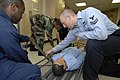US Navy 070621-N-0194K-003 Hospital Corpsman 2nd Class Samuel Hutcheson conducts stretcher bearer training aboard Military Sealift Command hospital ship USNS Comfort (T-AH 20).jpg