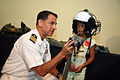 US Navy 070829-N-3271W-002 Capt. Herman Shelanski, commanding officer of USS Harry S. Truman, suits up a young pilot at the St. Louis Science Center.jpg
