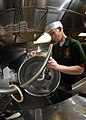 US Navy 071105-N-7981E-315 Boatswain's Mate Seaman Jake Kellner cleans pots and pans in the scullery aboard Arleigh Burke-class guided-missile destroyer USS Shoup.jpg