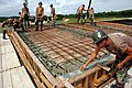 US Navy 071121-N-7367K-002 Seabees with U.S. Naval Mobile Construction Battalion (NMCB) 1, Guam Det., began laying concrete in one section of the roof of the Orote Point concrete masonry unit-block mechanics' shop on board Nava.jpg