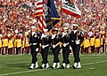 US Navy 080101-N-8607R-062 The Naval Base Ventura County Honor Guard parades the colors as the University of Southern California Marching Band performed the national anthem during the 2008 Rose Bowl game.jpg