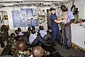 US Navy 080724-G-2443T-002 Petty Officer 3rd Class Caroline Gehring, assigned to the U.S. Coast Guard Cutter Dallas (WHEC 716), demonstrates basic first-aid procedures.jpg