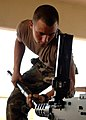 US Navy 081014-N-8816D-256 Builder 3rd Class Justin Koontz reinserts the barrel of a .50 caliber machine gun.jpg