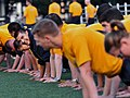 US Navy 081017-N-0807W-088 Sailors assigned to the Whidbey Island-class dock landing ship USS Tortuga (LSD 46) warm-up before participating in the Navy's Fall physical fitness assessment.jpg