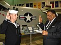 US Navy 081203-N-0000I-001 Mayor Samuel Jones administers the oath of enlistment to Electronics Technician 1st Class Timothy Reul, assigned to the littoral combat ship.jpg