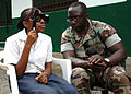 US Navy 090416-N-1655H-116 Hospital Corpsman 2nd Class Sule Abiodun tests the vision of a school girl during a medical civic action program visit to Gabon's capital city as part of Africa Partnership Station (APS).jpg