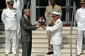 US Navy 090721-N-2386B-002 Deputy Supreme Allied Commander Transformation, Italian Navy Adm. Luciano Zappata (right), presents at gift to most honored guest, Belgium Minister Counselor.jpg