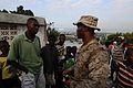 US Navy 100206-N-2735T-306 Cpl. Tristan Wilkerson, from New Orleans, assigned to the 24th Marine Expeditionary Unit (24th MEU), speaks to a community leader during a reconnaissance patrol.jpg
