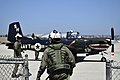 US Navy 100715-N-5346R-002 An ROTC midshipman prepares to take a ride in a T-35C training aircraft as part of Career Orientation Training for Midshipmen Aviation Week at Naval Base Coronado.jpg
