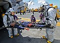 US Navy 101016-N-3237D-083 crash and salvage team removes an injured Sailor from a helicopter during a mass casualty drill aboard the multi-purpos.jpg