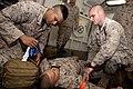 US Navy 110428-N-QP268-007 Cpl. Michael Diaz, right, reaches into a medical bag as Cpl. Joseph Diiorio, right, simulates applying a tourniquet to S.jpg