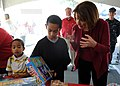 US Navy 111210-N-GI540-164 U.S. Rep. Susan Davis helps children of military families pick out their toys during the annual Our Gift To You Event in.jpg