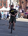 Unicycling Bagpiper (4411733681).jpg