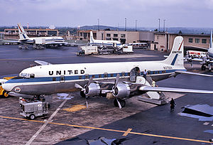 Baltimore–Washington International Airport - United Airlines Douglas DC-6B at Friendship Airport in 1967 with old terminal in background.