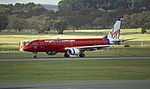 Virgin Blue (VH-ZPF) Embraer ERJ-190AR taking off on the main runway at Canberra Airport.jpg