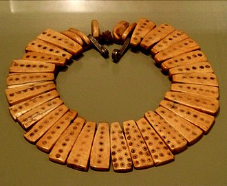 Lega people - This necklace may have been part of the jewelry belonging to the Bwami religious and social organization. It is made of elephant ivory