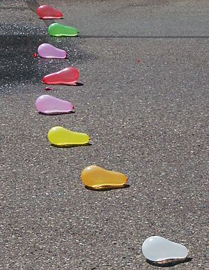 Water balloon - Eight water balloons on pavement