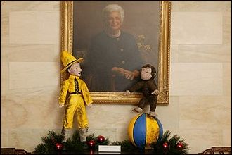 Curious George - The White House 2003 Christmas decoration using Curious George as the theme with the Barbara Bush portrait.