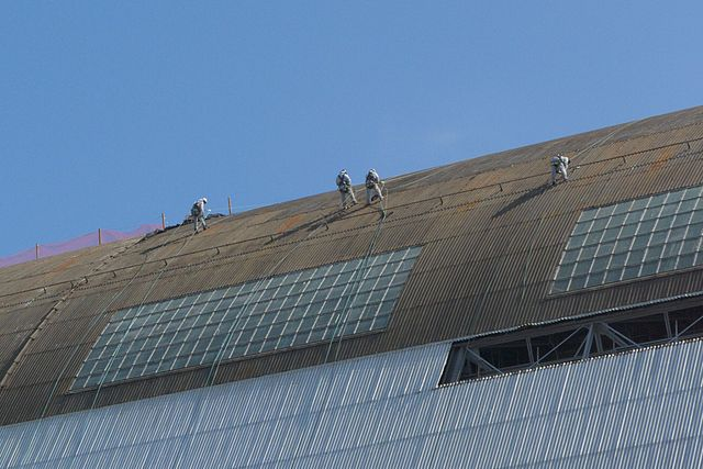 File Workers Rappelling Down The Side Of The Building