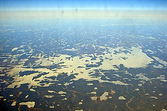 Wunnumin Lake First Nation - Aerial view of Wunnummin Lake, with the community of Wunnummin Lake in centre left.