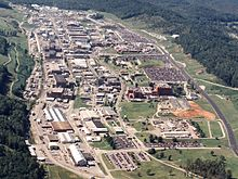 aerial view of a cluster of buildings on a wooded mountainside