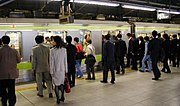 Passengers prepare to board a train on the Yamanote Line