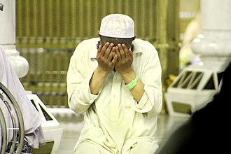 Dua - A young Muslim supplicating after salah at the Great Mosque of Mecca, Saudi Arabia.