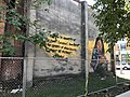 """""""Slavery of Other Animals"""" mural (2014; Nether and Stefan Ways, artists) Vacant rowhouses, 2011 Greenmount Avenue, Baltimore, MD 21218 (48998856662).jpg"""