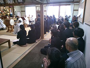 Nichiren Shōshū - A group of Hokkeko members of Nichiren Shoshu Buddhism during gongyo services in Nagano, Japan.