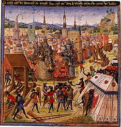 A depiction o the capture o Jerusalem in 1099 frae a medieval manuscript. The burnin biggins o Jerusalem are centered in the image. The various crusaders are surroondin an besiegin the veelage airmed for an attack.