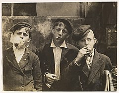 11-00 A.M. Monday, May 9th, 1910. Newsies at Skeeter's Branch, Jefferson near Franklin. They were all smoking. Location- St. Louis, Missouri. MET DP352686.jpg