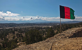 Paktika Province - The Afghan national flag overlooks a valley from an observation post at Paktika province in Afghanistan