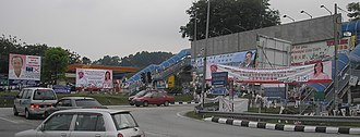 Malaysian general election, 2008 - Campaign banners at Taman Kinrara, Selangor. The state assembly seat of Kinrara is contested by both  National Front (represented by incumbent Kaw Cheong Wei) and the Democratic Action Party (represented by Teresa Kok Suh Sim). Also depicted are incumbent Lau Yeng Peng (BN-Gerakan) and Gobind Singh Deo (DAP), contesting for the parliamentary seat of Puchong.