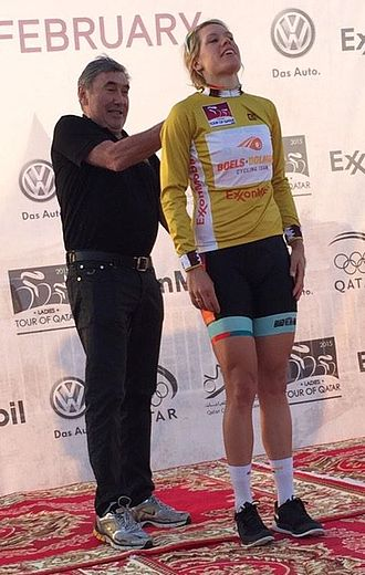 Tour of Qatar - Eddy Merckx presenting Ellen van Dijk with the gold leader's jersey after the first stage of the 2015 Ladies Tour of Qatar.