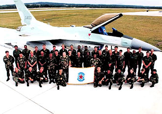 26th Space Aggressor Squadron - Crew group shot from the 26th Aggressor Squadron which never did in the end activate at Kadena AB. The aircraft is F-16C Block 30K 88-0403.